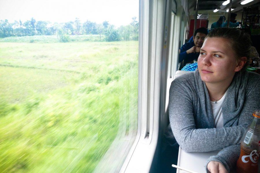 Livia enjoys the peaceful journey through the Java countryside